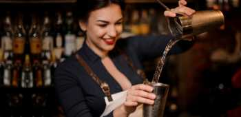 Girl bartender pouring water
